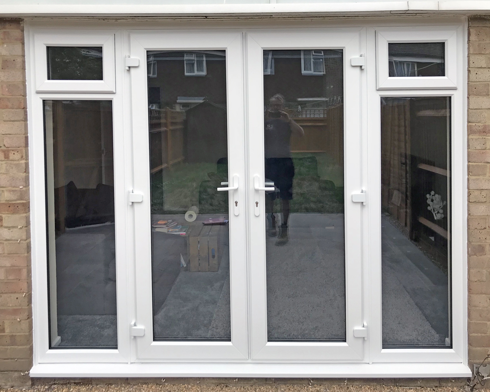 White uPVC French doors and sidelights fitted in Woking